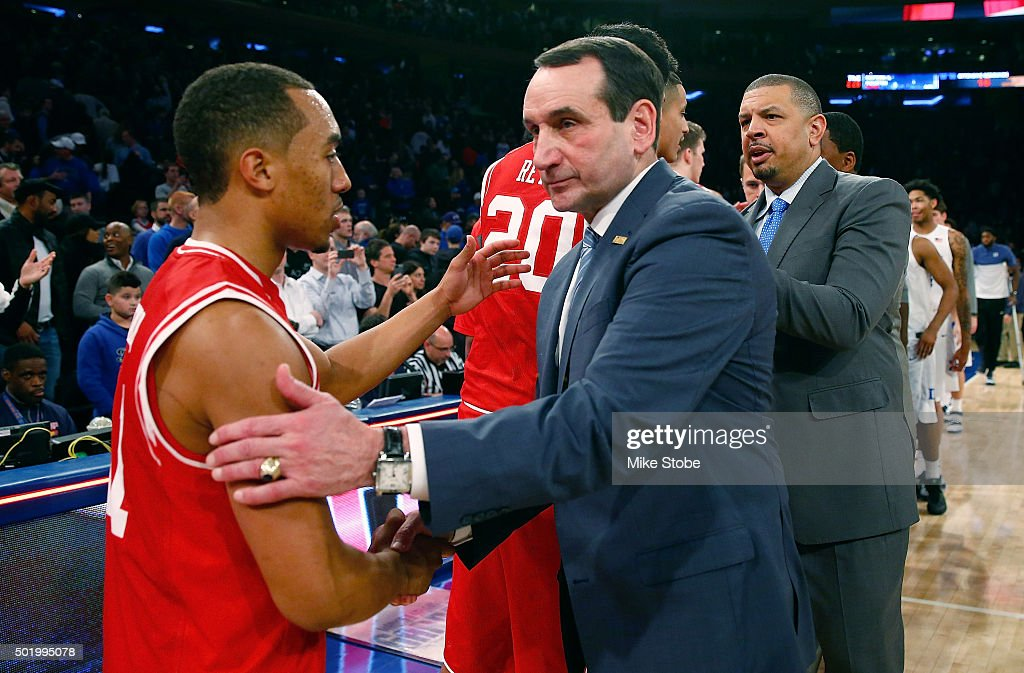 head coach Mike Krzyzewski of the Duke Blue Devils shakes hands with Brandon Taylor #11 of the Utah Utes following the game during the Ameritas Insurance Classic at Madison Square Garden on December 19, 2015 in New York City.