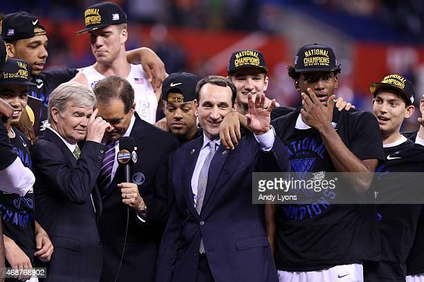 Head coach Mike Krzyzewski of the Duke Blue Devils speaks to NCAA President Dr Mark Emmert and CBS correspondent Jim Nantz after defeating the...