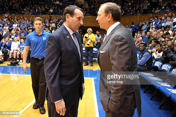 Head Coach Mike Krzyzewski of the Duke Blue Devils speaks with Head Coach Dan Monson of the Long Beach State 49ers prior to their game at Cameron...