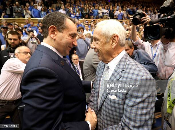 Head coach Mike Krzyzewski of the Duke Blue Devils talks to head coach Roy Williams of the North Carolina Tar Heels before their game at Cameron...
