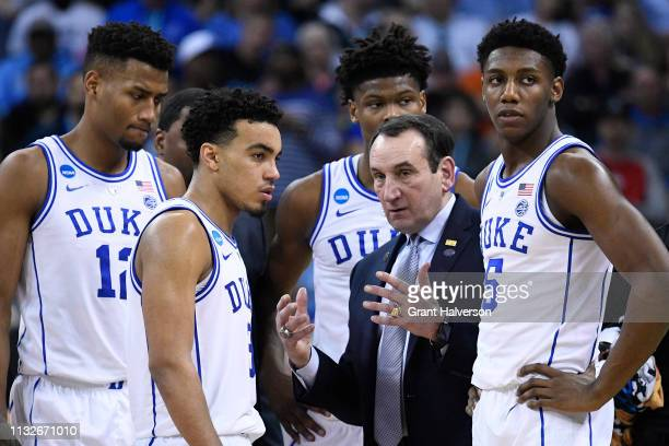 Head coach Mike Krzyzewski of the Duke Blue Devils talks to his team during a time out in the game against the UCF Knights in the second round of the...