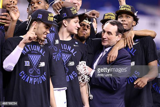 Head coach Mike Krzyzewski of the Duke Blue Devils watches One Shining Moment with his team after defeating the Wisconsin Badgers during the NCAA...
