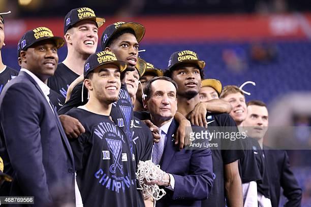 "Head coach Mike Krzyzewski of the Duke Blue Devils watches ""One Shining Moment"" with his players Jahlil Okafor, Tyus Jones, Amile Jefferson, Grayson..."