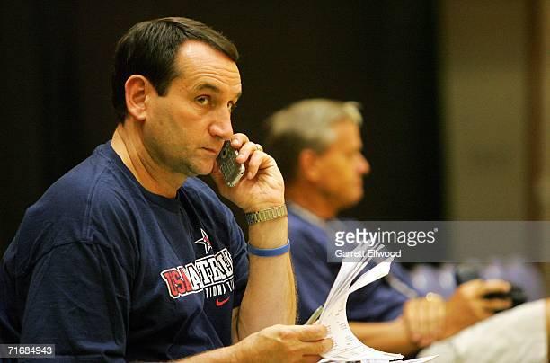 Head Coach Mike Krzyzewski of the USA Basketball Senior Men's National Team speaks on the phone during practice at the Hokkaido Perfectual Sports...