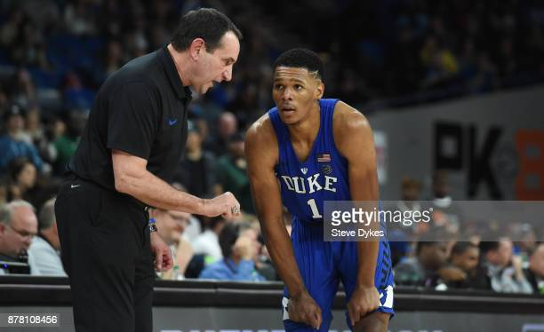 Head coach Mike Krzyzewski speaks with Trevon Duval of the Duke Blue Devils during the second half of the game against the Portland State Vikings at...