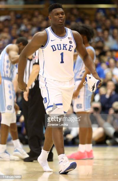 Head coach Mike Krzyzewski watches Zion Williamson of the Duke Blue Devils react after falling as his shoe breaks against Luke Maye of the North...