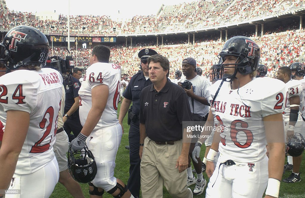 Head Coach Mike Leach of the Texas Tech Red Raiders walks on the field with his players after losing the NCAA Pigskin Classic against the Ohio State Buckeyes on August 24, 2002 at Ohio Stadium in Columbus, Ohio. Ohio State defeated Texas Tech 45-21.