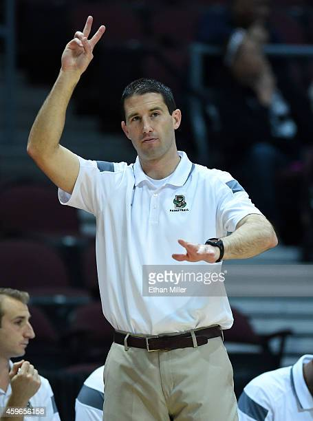 Head coach Mike Martin of the Brown Bears signals his players as they take on the Austin Peay Governors during the 2014 Continental Tire Las Vegas...