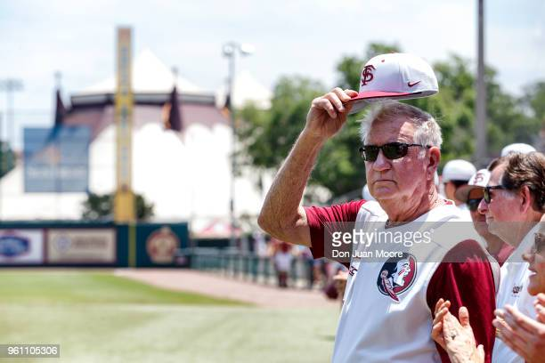 Head Coach Mike Martin of the Florida State Seminoles tilt his cap to the fans while being honored as college baseball's alltime winningest coach...
