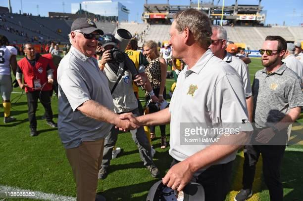 Head coach Mike Martz of the San Diego Fleet shakes hands with head coach Rick Neuheisel of the Arizona Hotshots after the Alliance of American...