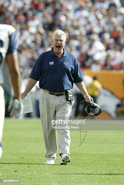 Head coach Mike Martz of the St Louis Rams walks on the field during a game against the Denver Broncos on September 8 2002 at Sports Authority Field...
