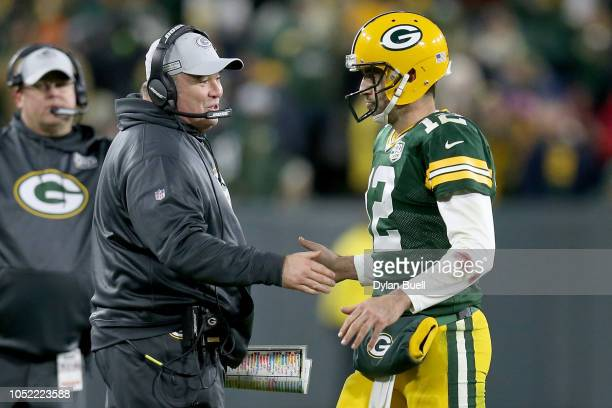 Head coach Mike McCarthy and Aaron Rodgers of the Green Bay Packers celebrate after scoring a touchdown in the fourth quarter against the San...
