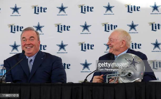 Head coach Mike McCarthy of the Dallas Cowboys and Dallas Cowboys owner Jerry Jones talk with the media during a press conference at the Ford Center...