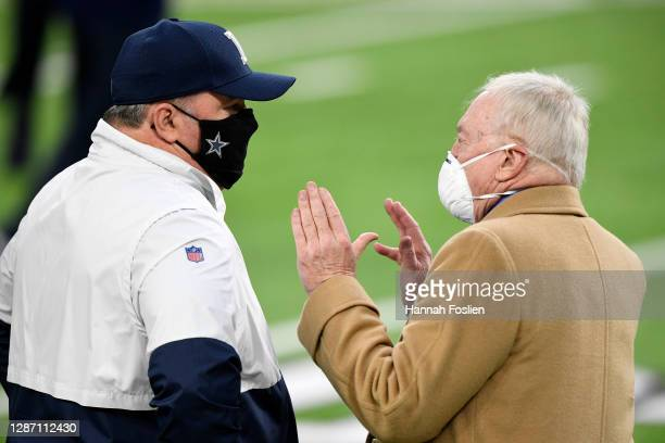 Head coach Mike McCarthy of the Dallas Cowboys speaks with team owner Jerry Jones prior to their game against the Minnesota Vikings at U.S. Bank...