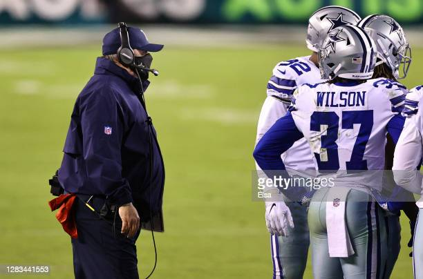 Head coach Mike McCarthy of the Dallas Cowboys walks on the field to talk with his players before the Cowboys attempt an on-side kick in the fourth...