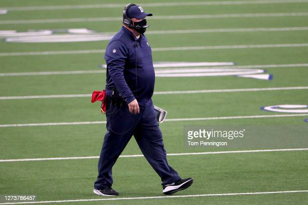 Head coach Mike McCarthy of the Dallas Cowboys walks onto the field as the Dallas Cowboys take on the Atlanta Falcons in the third quarter at AT&T...