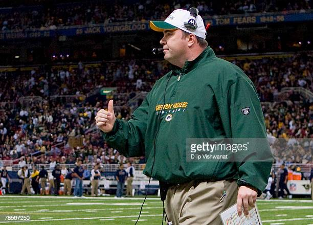 Head coach Mike McCarthy of the Green Bay Packers celebrates a touchdown against the St. Louis Rams at the Edward Jones Dome December 16, 2007 in St....