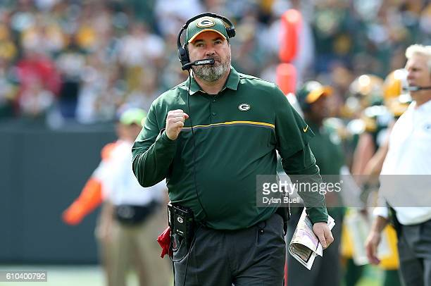 Head coach Mike McCarthy of the Green Bay Packers celebrates after scoring a touchdown in the first quarter against the Detroit Lions at Lambeau...