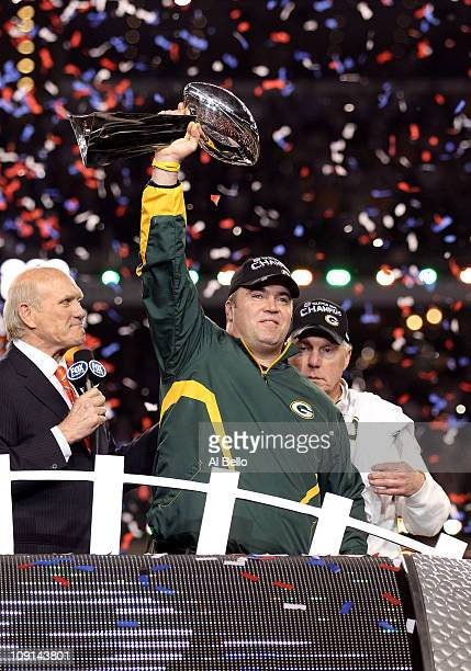 Head coach Mike McCarthy of the Green Bay Packers celebrates with the Vince Lombardi trophy following the Packers 31-25 win in Super Bowl XLV at...