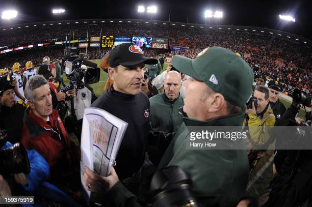 Head coach Mike McCarthy of the Green Bay Packers congratulates head coach Jim Harbaugh of the San Francisco 49ers after their NFC Divisional Playoff...
