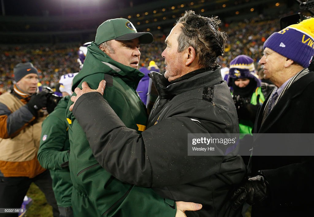 Head coach Mike McCarthy of the Green Bay Packers (L) greets head coach Mike Zimmer of the Minnesota Vikings after their game at Lambeau Field on January 3, 2016 in Green Bay, Wisconsin. The Minnesota Vikings defeated the Green Bay Packers with a score of 20 to 13.