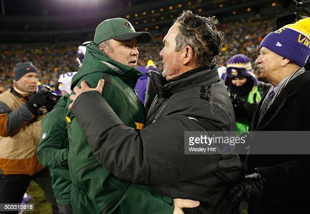 Head coach Mike McCarthy of the Green Bay Packers greets head coach Mike Zimmer of the Minnesota Vikings after their game at Lambeau Field on January...