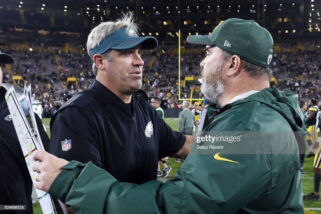 Head coach Mike McCarthy of the Green Bay Packers greets head coach Doug Pederson of the Philadelphia Eagles at midfield following a prseason game at Lambeau Field on August 10, 2017 in Green Bay, Wisconsin.