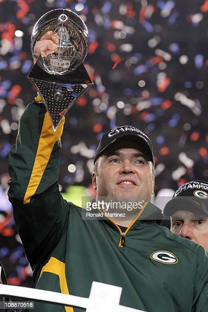 Head coach Mike McCarthy of the Green Bay Packers holds up The Vince Lombardi Trophy after the Green Bay Packers defeated the Pittsburgh Steelers 31...