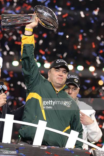 Head coach Mike McCarthy of the Green Bay Packers holds up the Vince Lombardi Trophy after winning Super Bowl XLV 31-25 against the Pittsburgh...