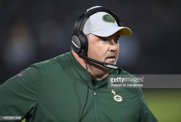 Head coach Mike McCarthy of the Green Bay Packers looks on from the sidelines against the Oakland Raiders during the first quarter of an NFL...