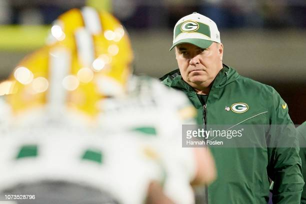 Head coach Mike McCarthy of the Green Bay Packers looks on while his players warm up before the game against the Minnesota Vikings at US Bank Stadium...