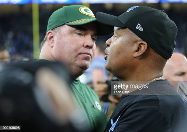 Head coach Mike McCarthy of the Green Bay Packers meets with head coach Jim Caldwell of the Detroit Lions on the field after the Lions defeated the...