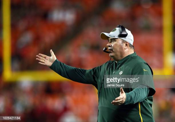 Head coach Mike McCarthy of the Green Bay Packers motions from the sidelines during the preseason game against the Kansas City Chiefs at Arrowhead...