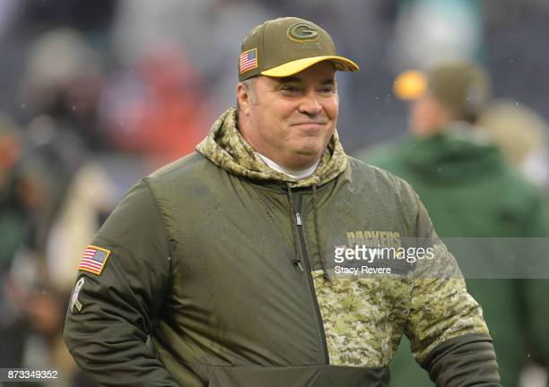 Head coach Mike McCarthy of the Green Bay Packers walks off the field after defeating the Chicago Bears 23-16 at Soldier Field on November 12, 2017...
