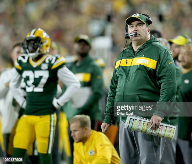Head coach Mike McCarthy of the Green Bay Packers watches from the sidelines during the second quarter of a game against the Chicago Bears at Lambeau...