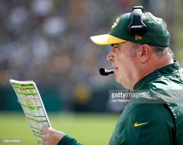Head coach Mike McCarthy of the Green Bay Packers watches from the sidelines during the second quarter of a game against the Minnesota Vikings at...