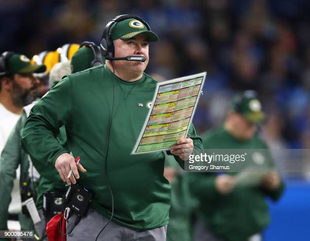 Head coach Mike McCarthy of the Green Bay Packers watches his team against the Detroit Lions during the first quarter at Ford Field on December 31...