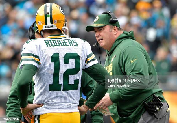 Head coach Mike McCarthy talks to Aaron Rodgers of the Green Bay Packers in the second quarter against the Carolina Panthers at Bank of America...