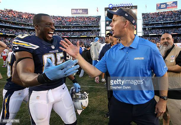 Head coach Mike McCoy and tight end Antonio Gates of the San Diego Chargers celebrate after the game against the Kansas City Chiefs at Qualcomm...