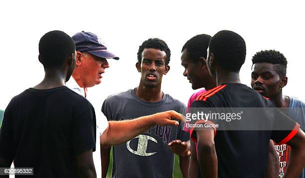 Head coach Mike McGraw gives instructions to a small group including facing left to right Abdiaziz Shaleh Taha Mahamat and Enock Citenga during...