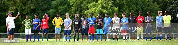 Head coach Mike McGraw has the attention of most on the line while cocaptain Maulid Abdow far right is eyetoeye with Derek Metivier during tryouts...