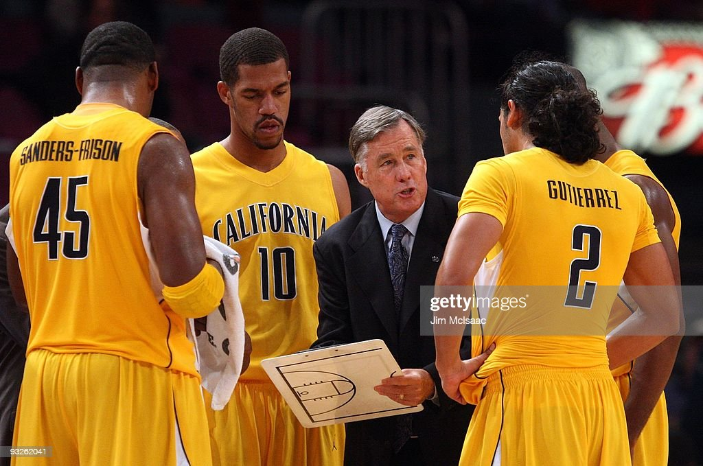 Head coach Mike Montgomery of the California Golden Bears goes over a play during a timeout against the Syracuse Orange during their semifinal game of the 2K Sports Classic on November 19, 2009 at Madison Square Garden in New York City.