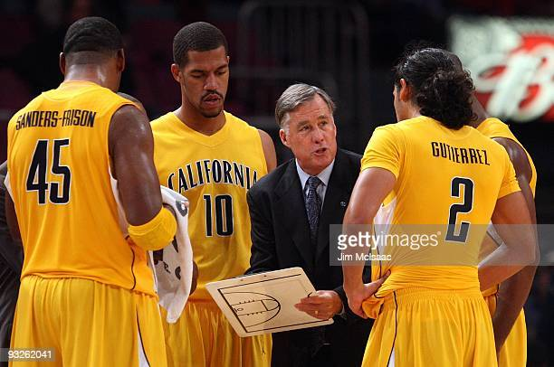 Head coach Mike Montgomery of the California Golden Bears goes over a play during a timeout against the Syracuse Orange during their semifinal game...