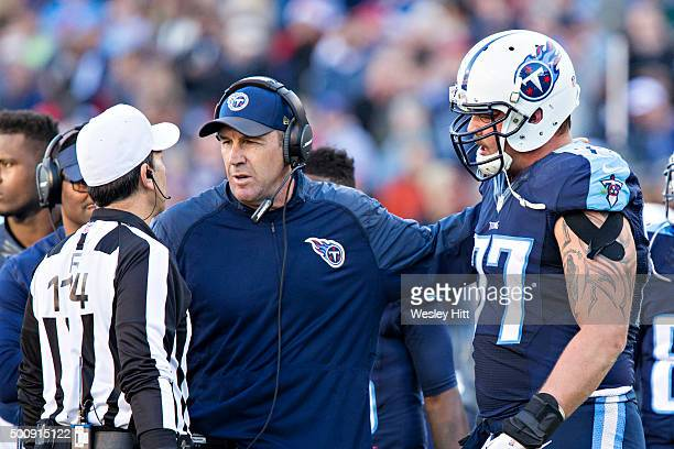Head Coach Mike Mularkey and Taylor Lewan of the Tennessee Titans talk with a official during a game against the Jacksonville Jaguars at Nissan...