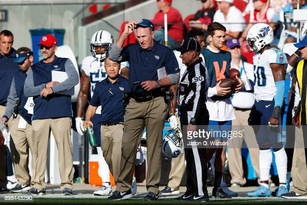 Head coach Mike Mularkey of the Tennessee Titans argues a call with line judge Mike Spanier during the second quarter against the San Francisco 49ers...