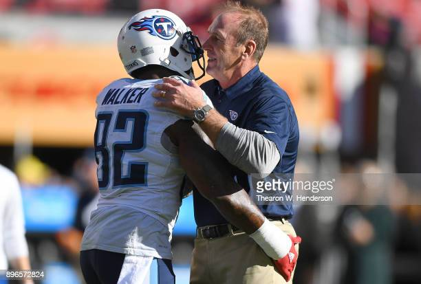 Head coach Mike Mularkey of the Tennessee Titans embraces his player Delanie Walker during pregame warm ups prior to the start of an NFL football...