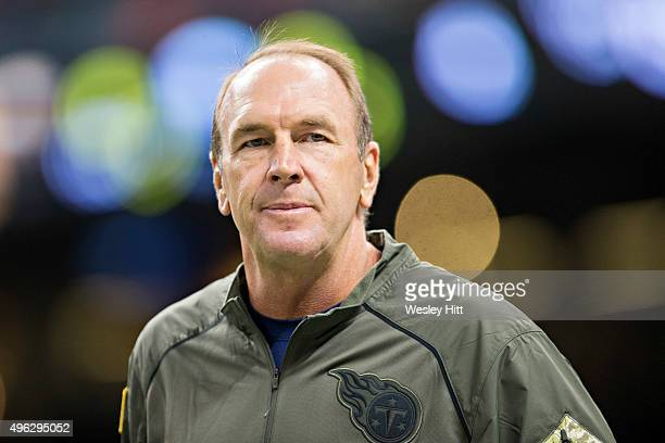 Head Coach Mike Mularkey of the Tennessee Titans watches his team warm up before a game against the New Orleans Saints at MercedesBenz Superdome on...