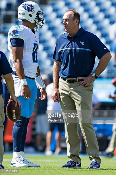 Head Coach Mike Mularkey talks with Marcus Mariota of the Tennessee Titans before a game against the Oakland Raiders at Nissan Stadium on September...