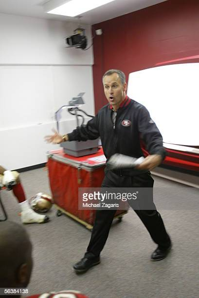Head Coach Mike Nolan of the San Francisco 49ers addresses the team in the locker room at halftime during the game against the Arizona Cardinals at...