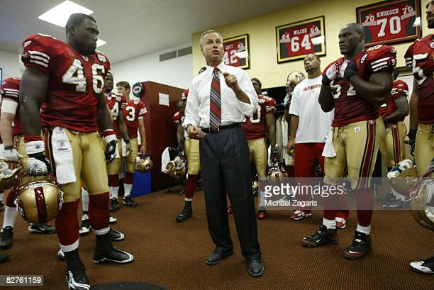 Head Coach Mike Nolan of the San Francisco 49ers addresses the team in the locker room at halftime during the NFL game against the Arizona Cardinals...